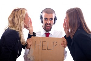 Businessman with Ear Protectors Hold Help Sign between Screaming Businesswoman